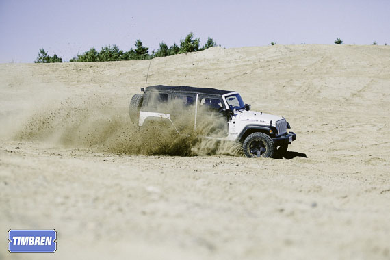 A Jeep Rubicon Unlimited Off-Road in the sand with Timbren Suspension Enhancement System